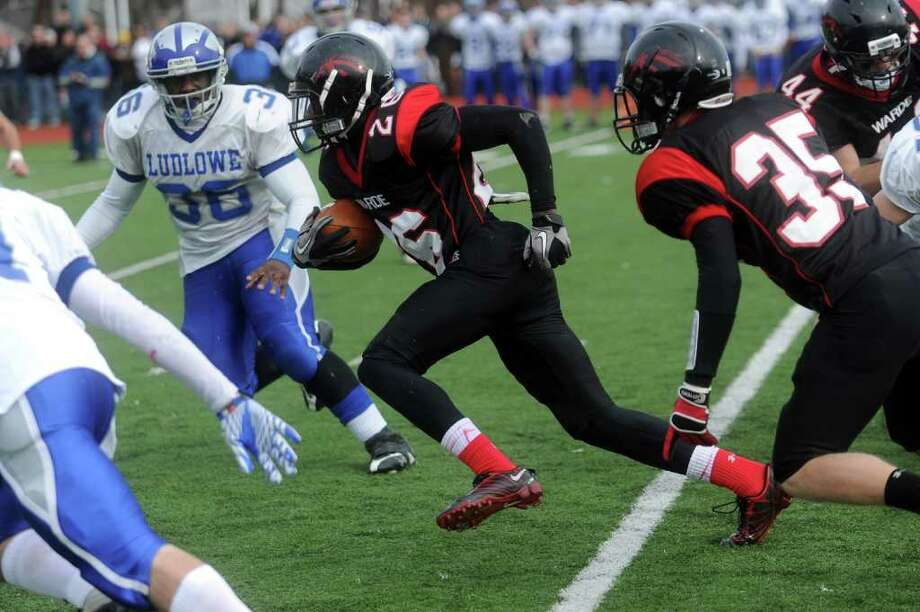 Warde's Craig Lowery carries the ball during Thursday's Thanksgiving Day game against Fairfield Ludlowe at Fairfield Warde High School on November 25, 2010. Photo: Lindsay Niegelberg / Connecticut Post