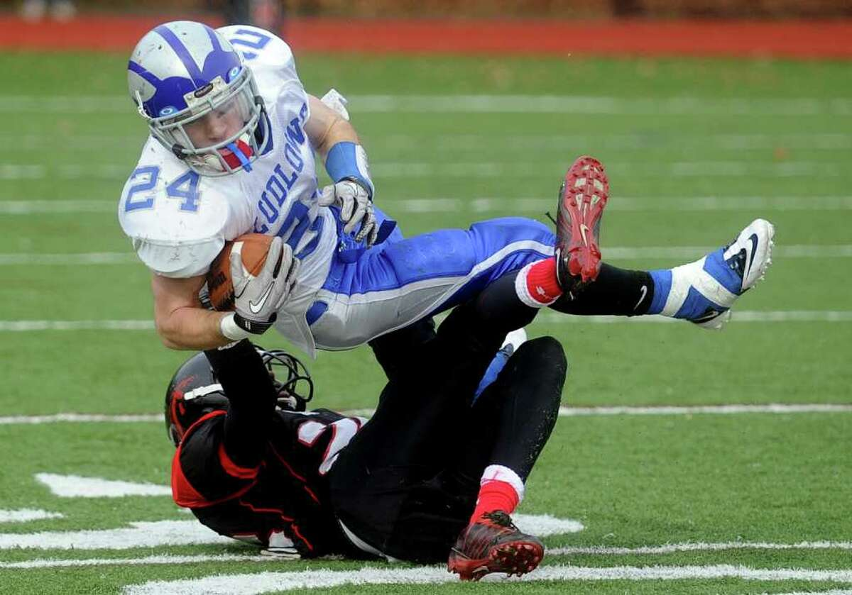 Fairfield Ludlowe's Nathan Ryan carries the ball during Thursday's Thanksgiving Day game at Fairfield Warde High School on November 25, 2010.