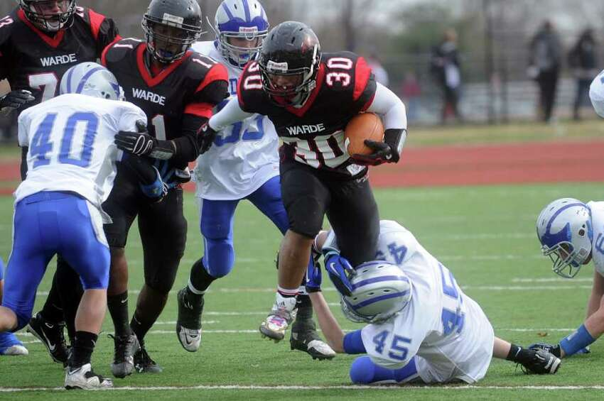 Warde's Alex Delaney carries the ball during Thursday's Thanksgiving Day game against Fairfield Ludlowe at Fairfield Warde High School on November 25, 2010.