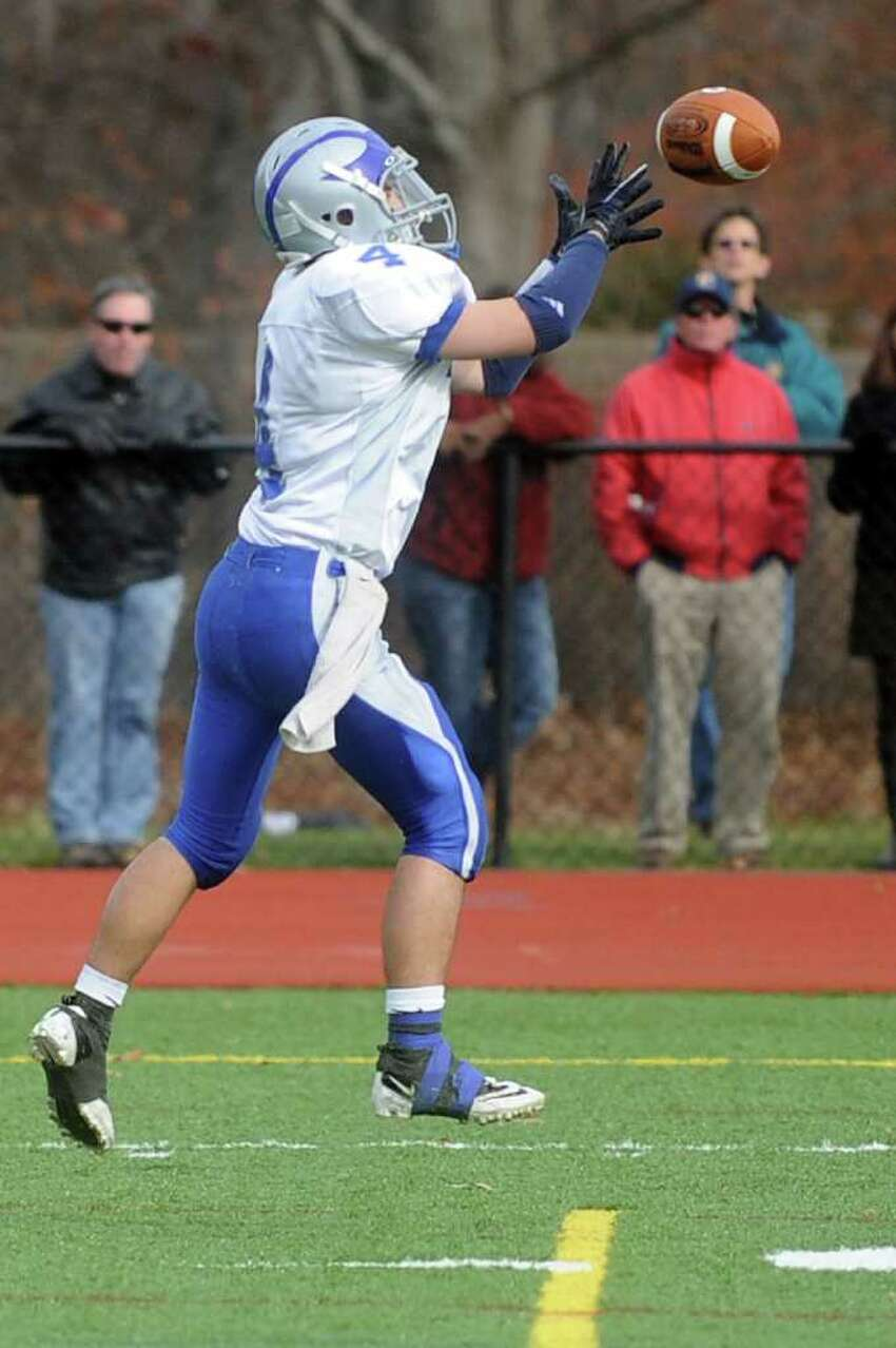 Ludlowe's Nicholas Fernandes catches an interception during Thursday's Thanksgiving Day game at Fairfield Warde High School on November 25, 2010.
