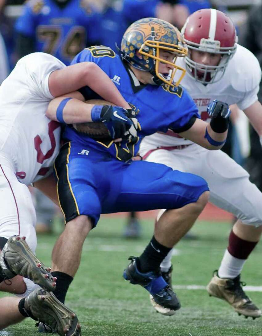 Brookfield's Brian Kelly is held up during a football game against Bethel at Brookfield. Thursday, Nov. 25, 2010