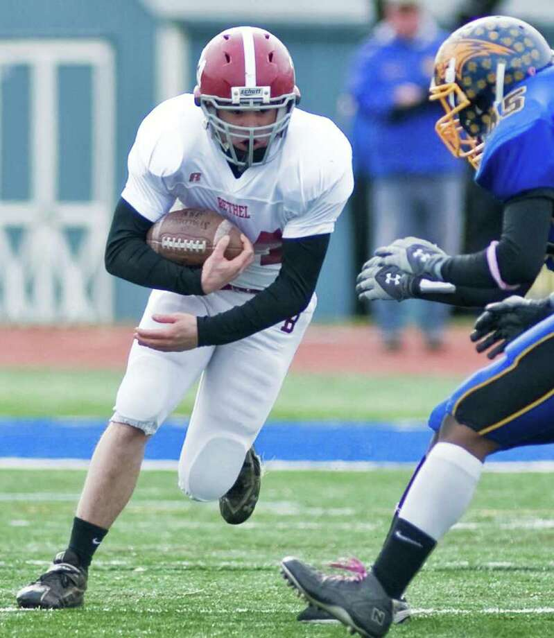 Bethel's Jonathon Matthews runs the ball at Brookfield during a football game at Brookfield. Thursday, Nov. 25, 2010 Photo: Scott Mullin / The News-Times Freelance