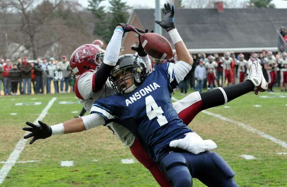 Naugatuck's Tyler Conklin breaks up a pass intended for Ansonia's Andrew Matos (4) during the Thanksgiving day football game at Jarvis Field at the Nolan Athletic Complex in Ansonia on Thursday, Nov. 25, 2010. Photo: Amy Mortensen / Connecticut Post Freelance