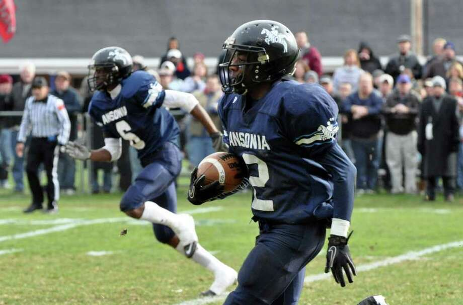 Ansonia's Arkeel Newsome (2) carries the ball for yardage during the Thanksgiving day football game against Naugatuck at Jarvis Field at the Nolan Athletic Complex in Ansonia on Thursday, Nov. 25, 2010. Photo: Amy Mortensen / Connecticut Post Freelance