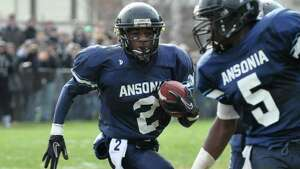 Ansonia's Arkeel Newsome (2) carries the ball for touchdown during the Thanksgiving day football game against Naugatuck at Jarvis Field at the Nolan Athletic Complex in Ansonia on Thursday, Nov. 25, 2010.