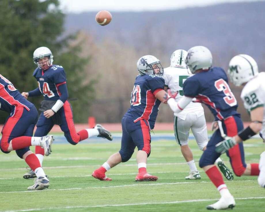 New Fairfield quarterback Mike Jamieson (14) fires a pass to Ryan Mallon Thursday, Nov. 25, 2010, at New Fairfield High School. Photo: Barry Horn / The News-Times Freelance