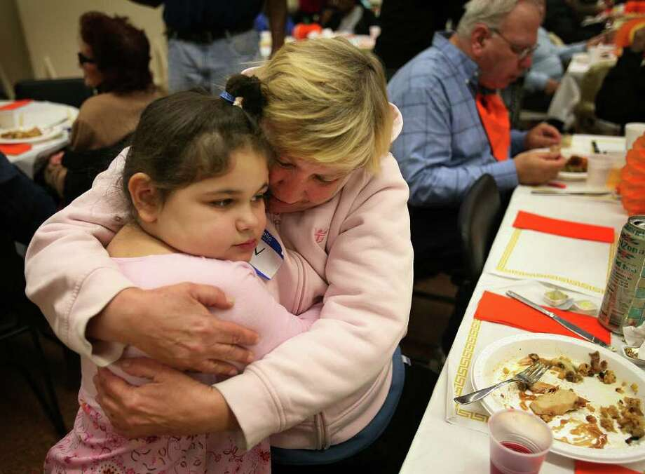 Nicole Rivera, 5, gets a hug from family friend Ann Schaffer, both of Bridgeport, at the 9th annual Thanksgiving Feast at the United Congregational Church at 877 Park Avenue in Bridgeport on Thursday, November 25, 2010. Photo: Brian A. Pounds / Connecticut Post