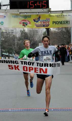 Matt Bogdan of Latham wins the the annual Turkey Trot race in Troy November 25, 2010 as Macky Lloyd of Voorheesville comes in second. (SKIP DICKSTEIN / TIMES UNION) Photo: Skip Dickstein