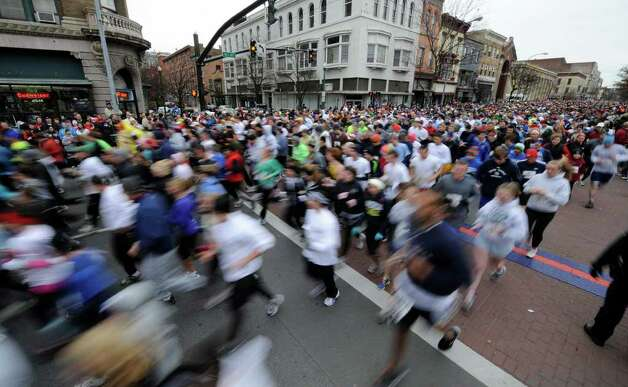 Thousands move down Fourth Avenue at the start of the annual Turkey Trot race in Troy November 25, 2010. (SKIP DICKSTEIN / TIMES UNION) Photo: Skip Dickstein