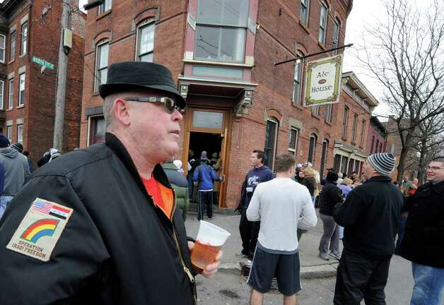 Timothy O'Brien enjoys the Troy Turkey Trot festivities outside the Ale House in Troy November 25, 2010. O'Brien, a sergeant in the National Guard, opted not to run the race this year after having run it for years in uniform and carrying an Army pack . (SKIP DICKSTEIN / TIMES UNION)Guard's 42nd Infantry (Rainbow) Division Photo: Skip Dickstein
