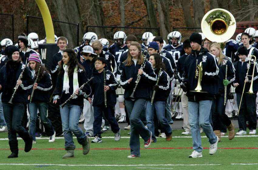 Wilton High School band performs during Thursday mornings game against Trinity Catholic.