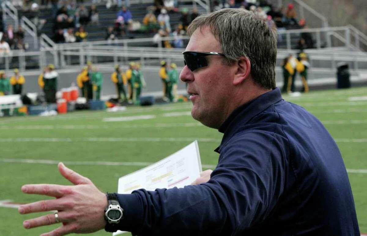 Wilton High School head football coach Bruce Cunningham during Thursday's game against Trinity Catholic.