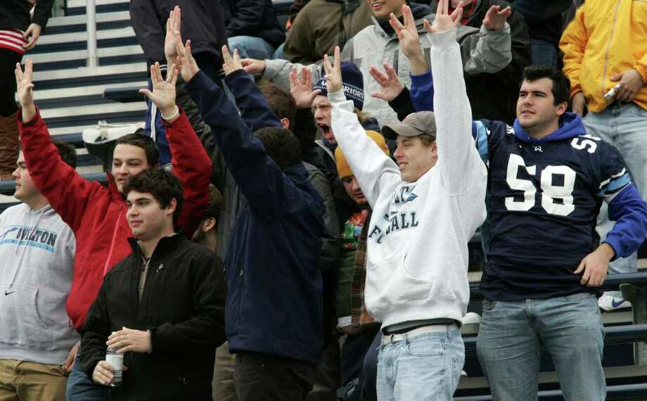 Wilton High School football fans react to the win over Trinity Catholic during Thursday mornings match-up. Photo: David Ames / Stamford Advocate