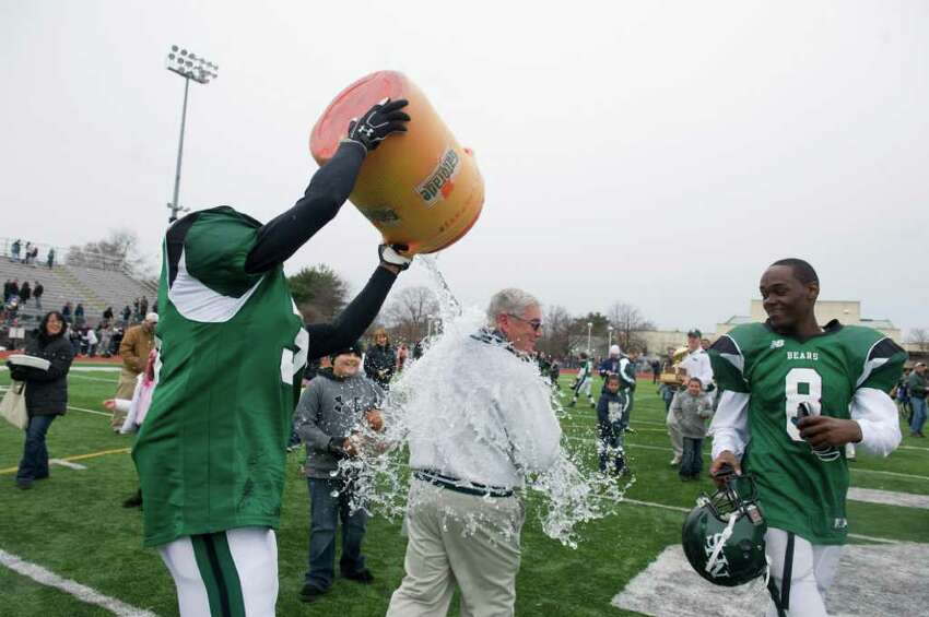 Norwalk Coach Pete Tucci gets doused after the team won the Sam Testa Trophy Thanksgiving Day, November 25, 2010. The Bears beat McMahon in a crosstown bout 8-7 in what was Tucci's final game.