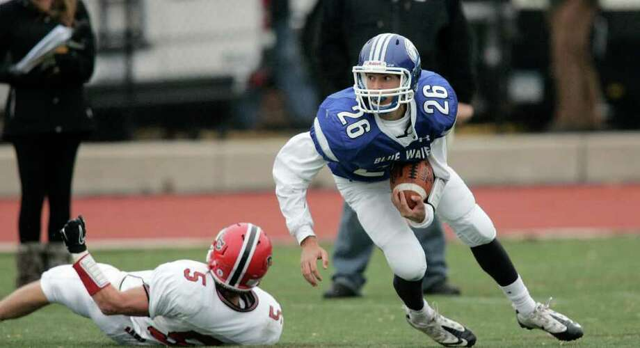 Darien RB Peter Gesauldi looks upfield for running room after faking out would be tackler Joe Costigan. Darien would have little running room on the day as they were easily beaten by New Canaan. Photo: J. Gregory Raymond / © J. Gregory Raymond for Stamford Advocate Freelance