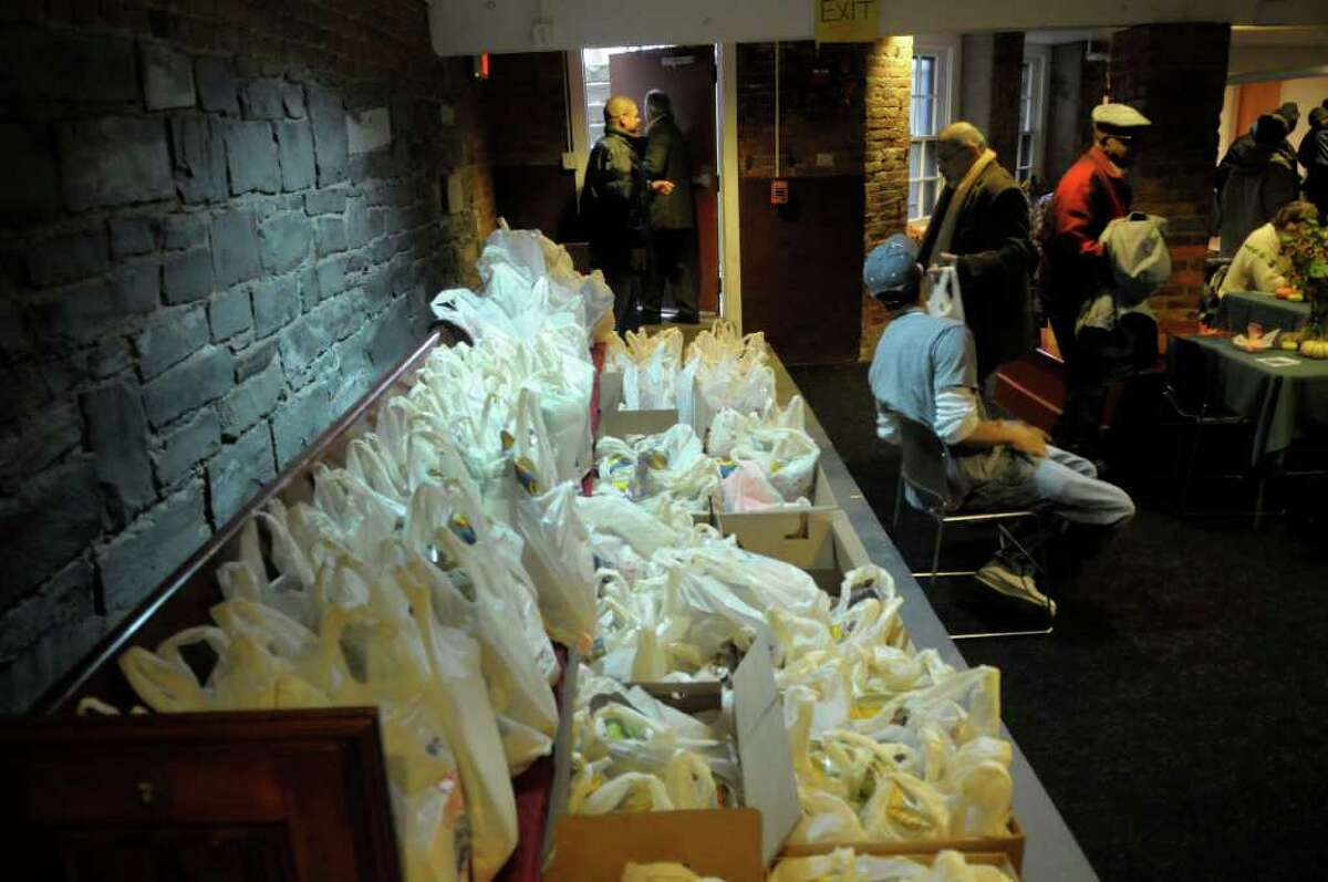 Bags with some food items for guests to take home as lined up during the Annual Equinox Thanksgiving Day Community Dinner at the First Presbyterian Church in Albany, NY on Thursday, Nov. 25, 2010. Hundreds of meals were served by volunteers at the church, and thousands of meals were also delivered to those in need who are home bound. (Paul Buckowski / Times Union)