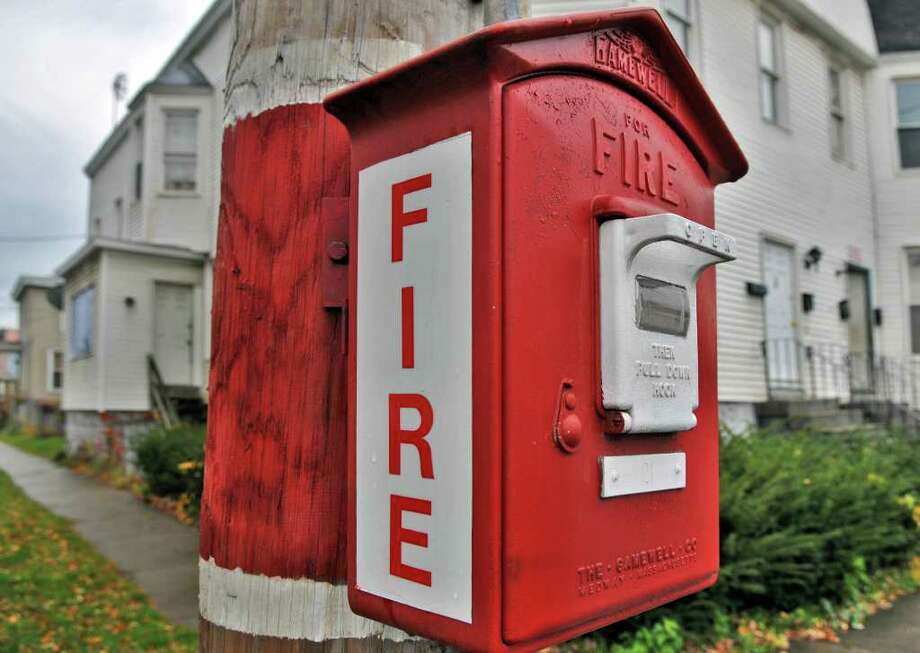 One of the more than 70 fire alarm boxes citywide that the city of Rensselaer wants to remove Tuesday afternoon November 23, 2010.  (John Carl D'Annibale / Times Union) Photo: John Carl D'Annibale / 00011172A