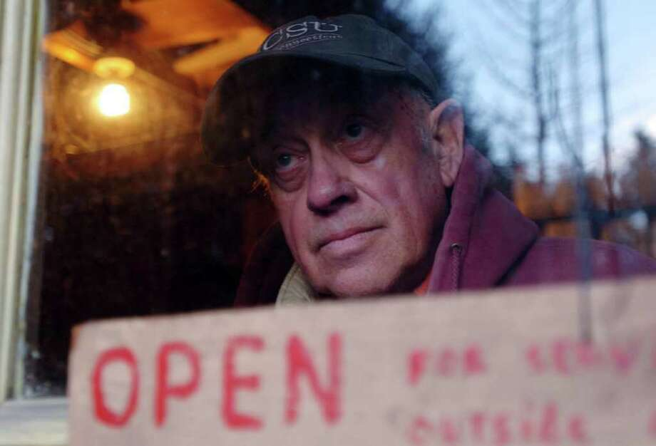 """Caesar Dambrowski, of Caesar's Nursery in Brookfield, looks out the window of his store before closing Nov. 24, 2010. """"I've been living here for 50 years,"""" Dambrowski said. Photo: Chris Ware / The News-Times"""