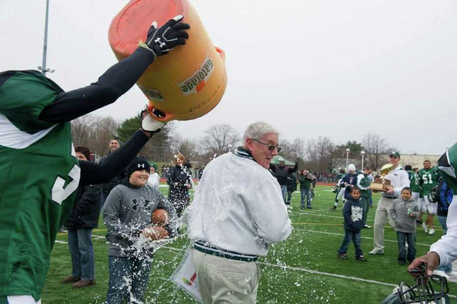 Norwalk Coach Pete Tucci gets doused after the team won the Sam Testa Trophy Thanksgiving Day, November 25, 2010. The Bears beat McMahon in a crosstown bout 8-7 in what was Tucci's final game. Photo: Keelin Daly / Greenwich Time