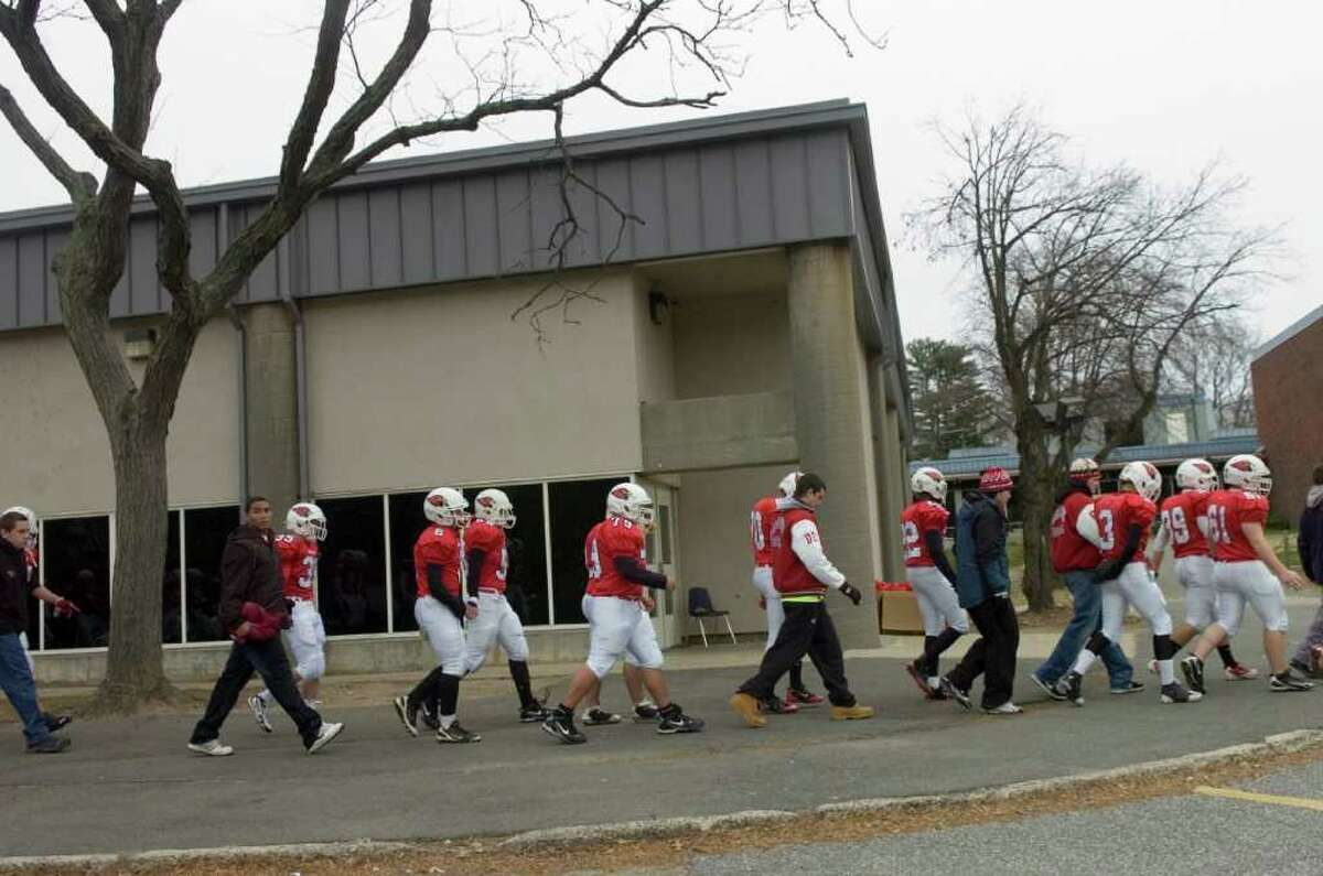 The Greenwich High School football team on their way to the the football game between Greenwich High School and Staples High School, hosted by Greenwich, on Thanksgiving, Thursday, Nov. 25, 2010.