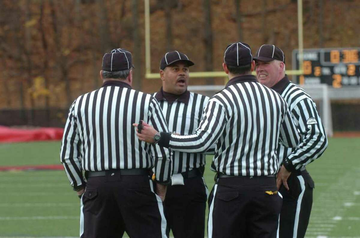 A group of umpires at the football game between Greenwich High School and Staples High School, hosted by Greenwich, on Thanksgiving, Thursday, Nov. 25, 2010.