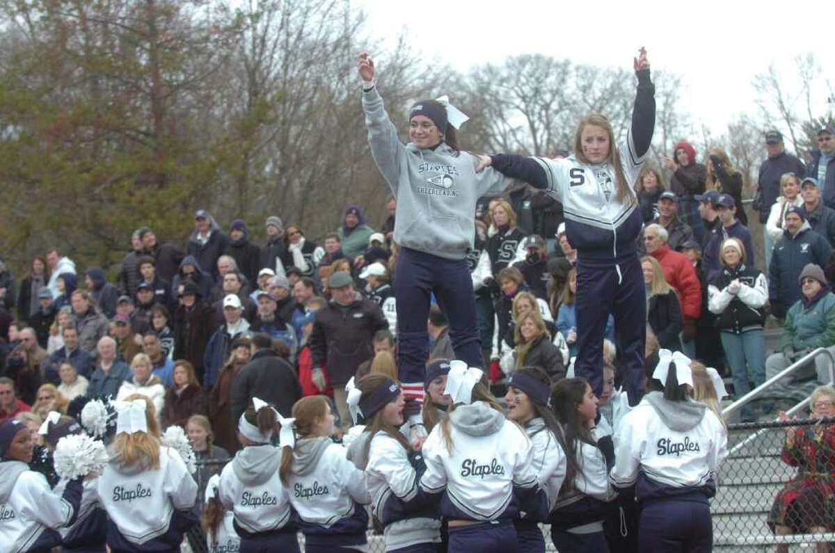 Staples High School's cheerleaders at the football game between Greenwich High School and Staples High School, hosted by Greenwich, on Thanksgiving, Thursday, Nov. 25, 2010.