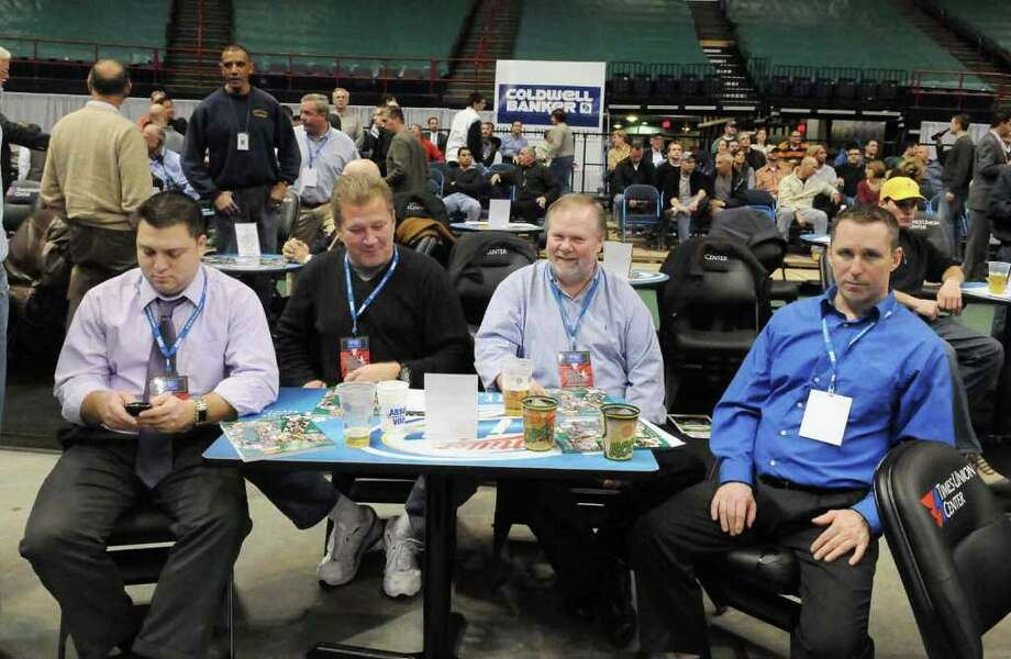 From left, Chris Read, and Mike Lewis, both of North Greenbush; Bobby Taaffe, of Albany and Dave Wilfore, of Latham, watch Siena College play against Butler University from the DeCrescente table, with premium VIP courtside seats and other amenities including a buffet dinner, halftime snack, valet parking and waiter service. The cost? $2,000 gets you two seats for the home basketball season at Times Union Center in Albany.  (Luanne M. Ferris / Times Union) Photo: Luanne M. Ferris