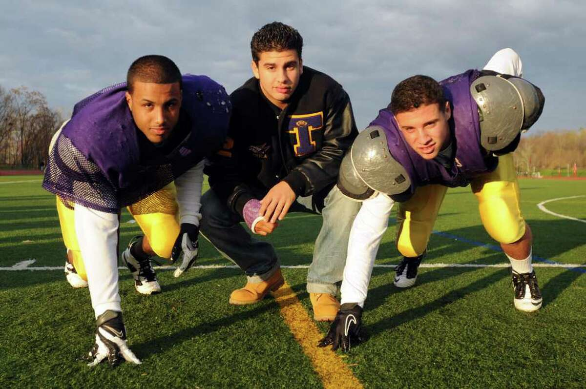 High school fall sports -- football -- Troy High School defensive ends Luis Lind, left, Victor Pirela, center, and Nick Valenti are all first-year starters, with Pirela and Valenti both 15-year-old sophomores. All have an uncanny ability to pressure opposing quarterbacks. (Cindy Schultz / Times Union)