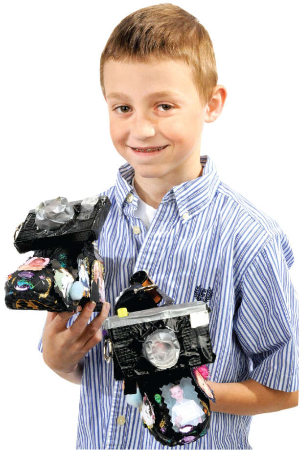 "Jared Taylor, the winner of the middle school category for his 3-D work called ""In Shoes On Shoes"" with his artwork in the Times Union studio in Colonie Friday afternoon November 19, 2010.  (John Carl D'Annibale / Times Union) Photo: John Carl D'Annibale"