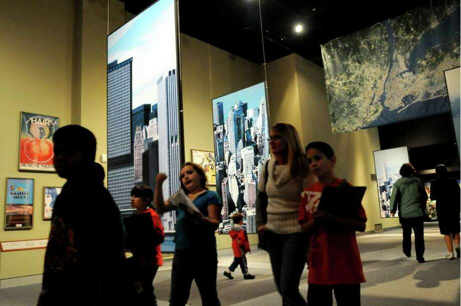 A school group walks through the New York City exhibit on Tuesday, Nov. 16, 2010, at the State Museum in Albany. The museum is slated to close on Sundays. (Cindy Schultz / Times Union) Photo: Cindy Schultz