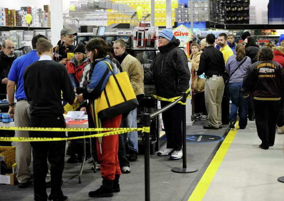 Shoppers look over the deals at the Best Buy in Wilton on Black Friday, Nov. 26, 2010. (Skip Dickstein / Times Union) Photo: Skip Dickstein