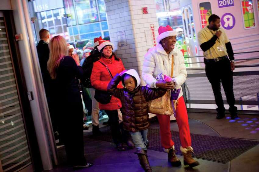 NEW YORK - NOVEMBER 25: Shoppers are let into Toys