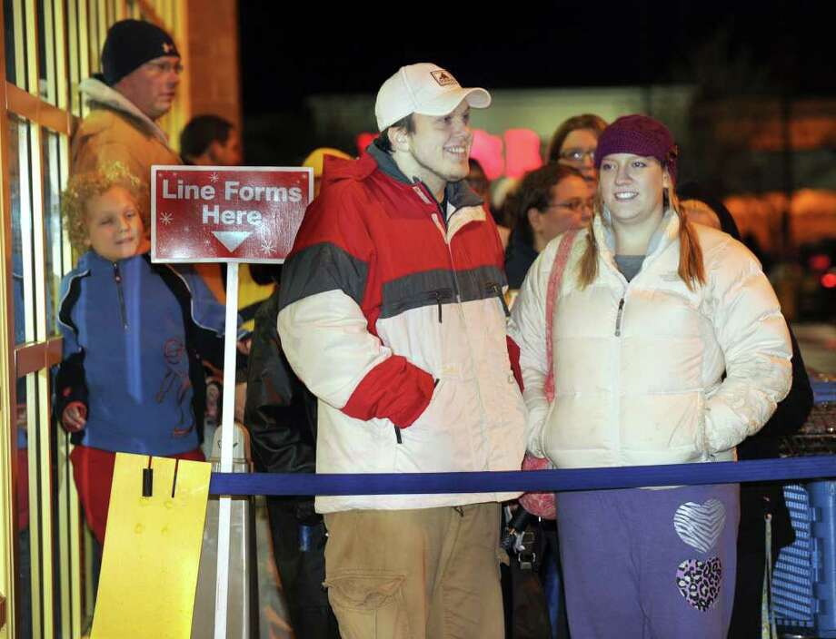 Michael and Lily Oliveira of Danbury waited three hours to be the first in line at Toys R Us for the 10 p.m. opening of the store on Thanksgiving night. Photo: Carol Kaliff / The News-Times