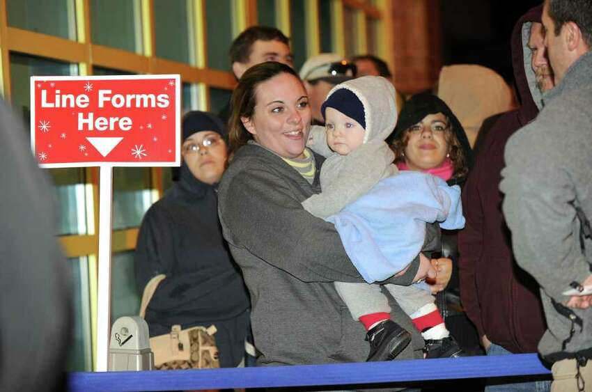 Amanda Williams of New Milford waited in line with her 9 1/2-month-old son Gavin at Toys R Us in Danbury. The store opened at 10 p.m. Thanksgiving night to give shoppers an early start on Black Friday shopping. Photo taken Thursday, Nov. 25, 2010.