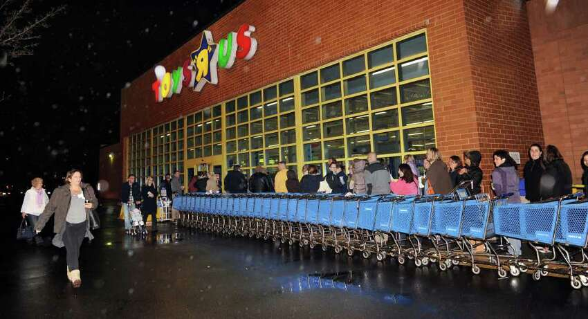 Custumers line up at Toys R Us in Danbury for the 10 p.m. opening of the store Thanksgiving night. Photo taken Thursday, Nov. 25, 2010.