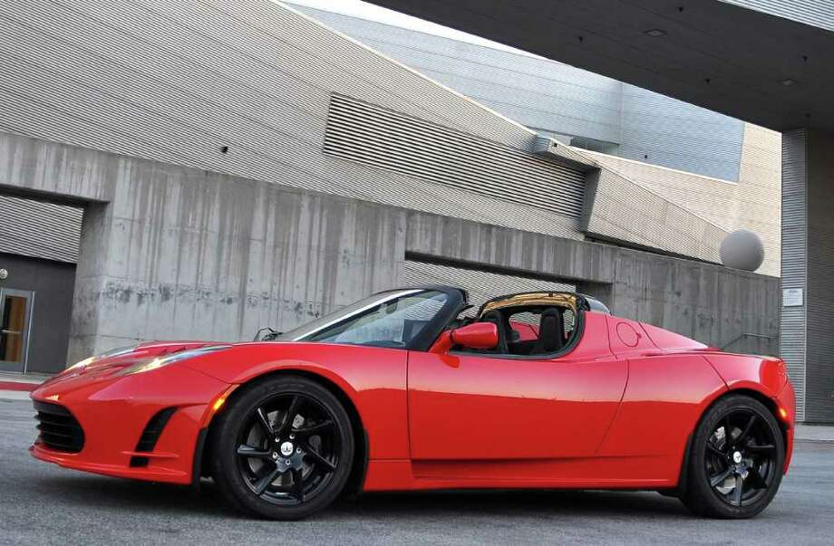 The round shape behind the driver's door that looks like gas cap most certainly is not on this all-electric Tesla roadster that was recently driven by a Hearst Connecticut staff writer. Photo: Contributed Photo / Stamford Advocate Contributed