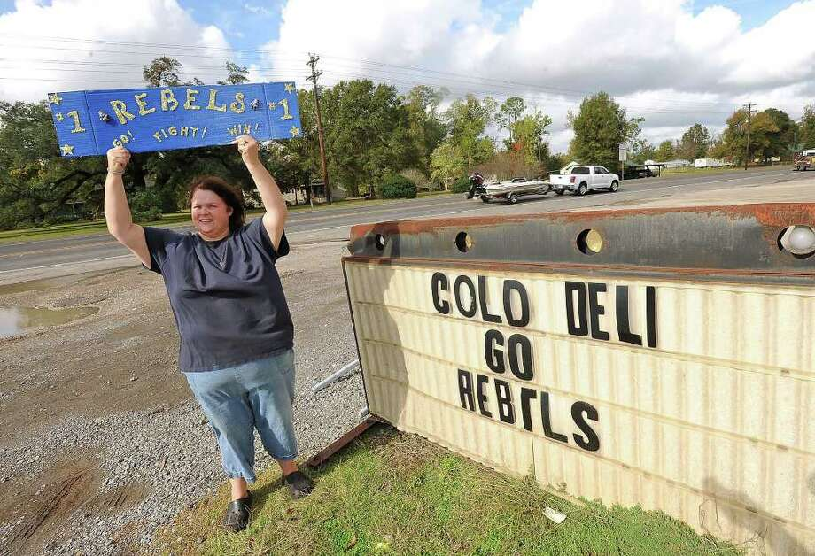 WIth its first playoff win since 1991, the Evadale Rebels will travel to College Station's Kyle Field to play Falls City on Friday. Mary Burch, mother of Rebel-player Chris Harvey, displays her support for the team on Wednesday. Guiseppe Barranco/The Enterprise Photo: Guiseppe Barranco / Beaumont