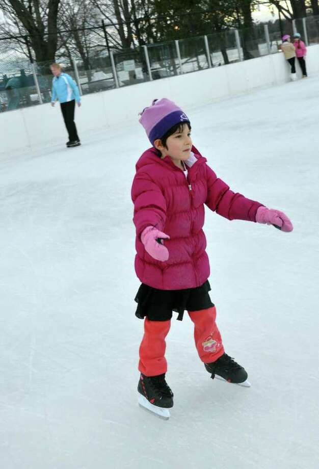 Chloe LaGattuta, 6, of New Canaan, skates with her arms outstretched at the rink at Longshore in Westport on Friday, Nov. 26, 2010. Photo: Amy Mortensen / Connecticut Post Freelance
