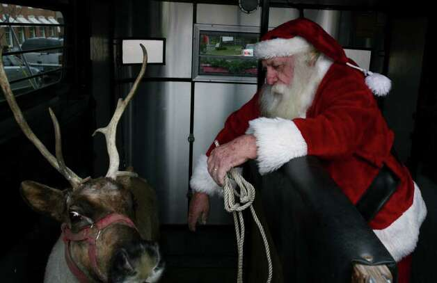 Santa Prepares To Unload One Of His Reindeer For A Trip 448139 Newstimes