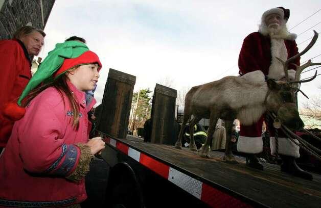 Savannah Madar Gets A Close Look At One Of Santa 39 S 448140 Newstimes