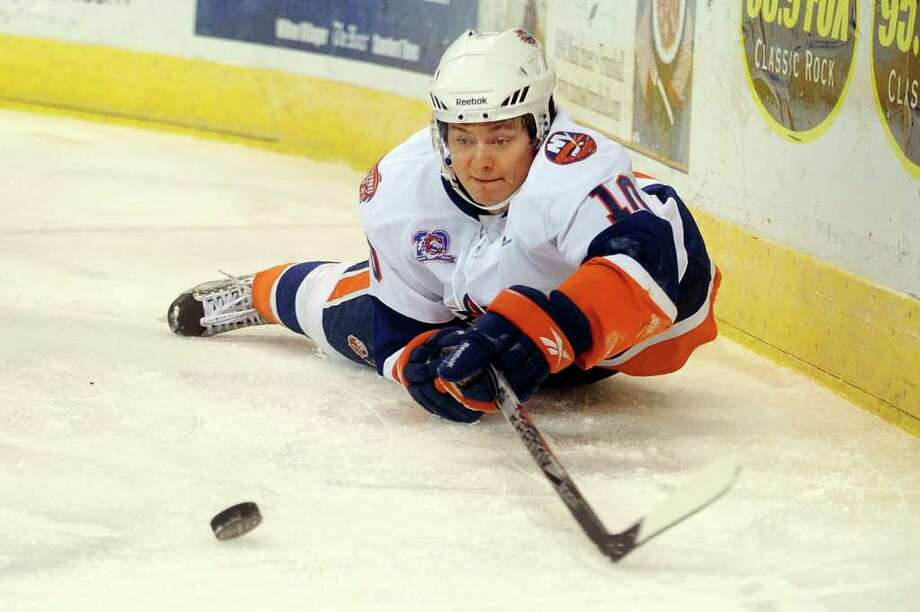 The Soundtigers' Rhett Rakhshani reaches for the puck after falling during Friday's game against the Hartford Wolf Pack at the Arena at Harbor Yard on November 26, 2010. Photo: Lindsay Niegelberg / Connecticut Post
