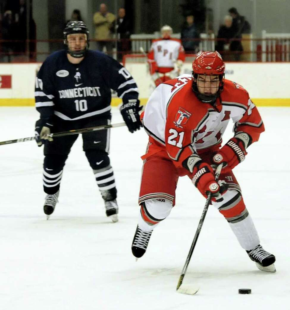 RPI's Chase Polacek, right, controls the puck as UConn's Daniel Naurato, left, defends. (Cindy Schultz / Times Union)