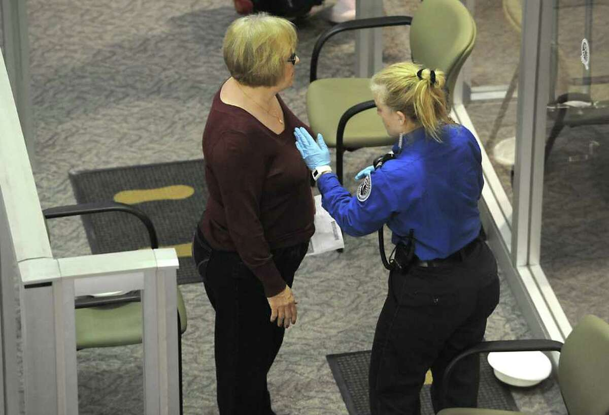 Passengers get a pat down by TSA workers at the Albany International Airport in Albany, NY on November 23, 2010. (Lori Van Buren / Times Union)