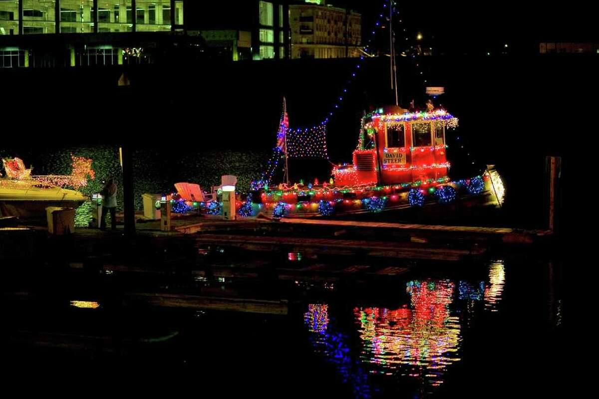 The fifth annual Stamford Harbor Parade of Lights featured numerous boats festooned wth lights cruising through the harbor accompanied by Christmas carols and revelry on the marina's docks. Here, the tugboat