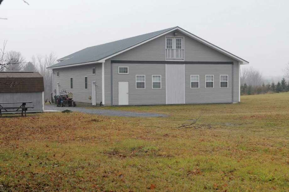 """In 2001, a Galway zoning officer rescinded the building permit she had issued for the construction of this airplane hangar after a resident complained she made multiple errors. Years later, after a planning process that pitted neighbors against one another, the town approved the building as a """"private garage"""" with 40-foot-wide doors. (Paul Buckowski / Times Union) Photo: Paul Buckowski / 00011180A"""