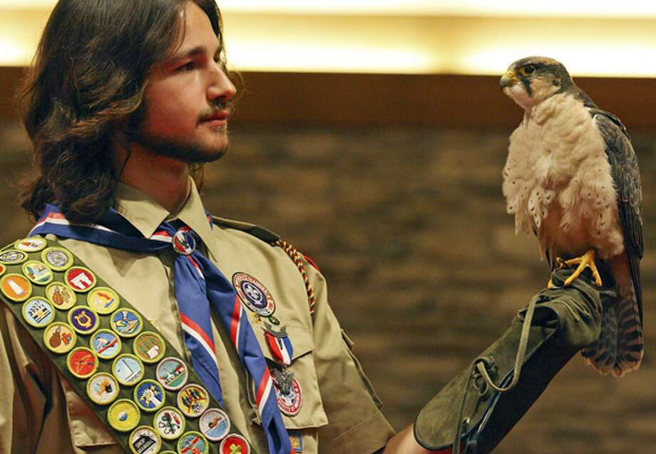 Eagle Scout Aaron Schulze holds a lanner falcon during a ceremony in which he was awarded his Eagle Scout neckerchief and medal at St. George Episcopal Church after earning all 129 merit badges.