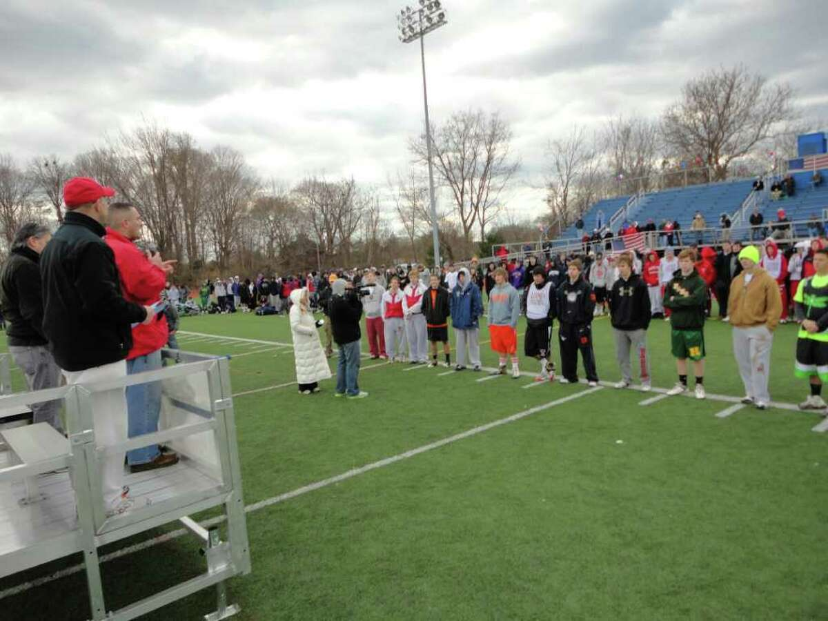 More than 200 lacrosse players from 25 teams throughout the state take a break from their day-long rotation of games at the Sticks for Soldiers tourney in Fairfield on Saturday to listen to remarks from several people, including the father of an injured U.S. Army specialist who is the beneficiary of their fund-raising efforts in the 5th annual benefit.