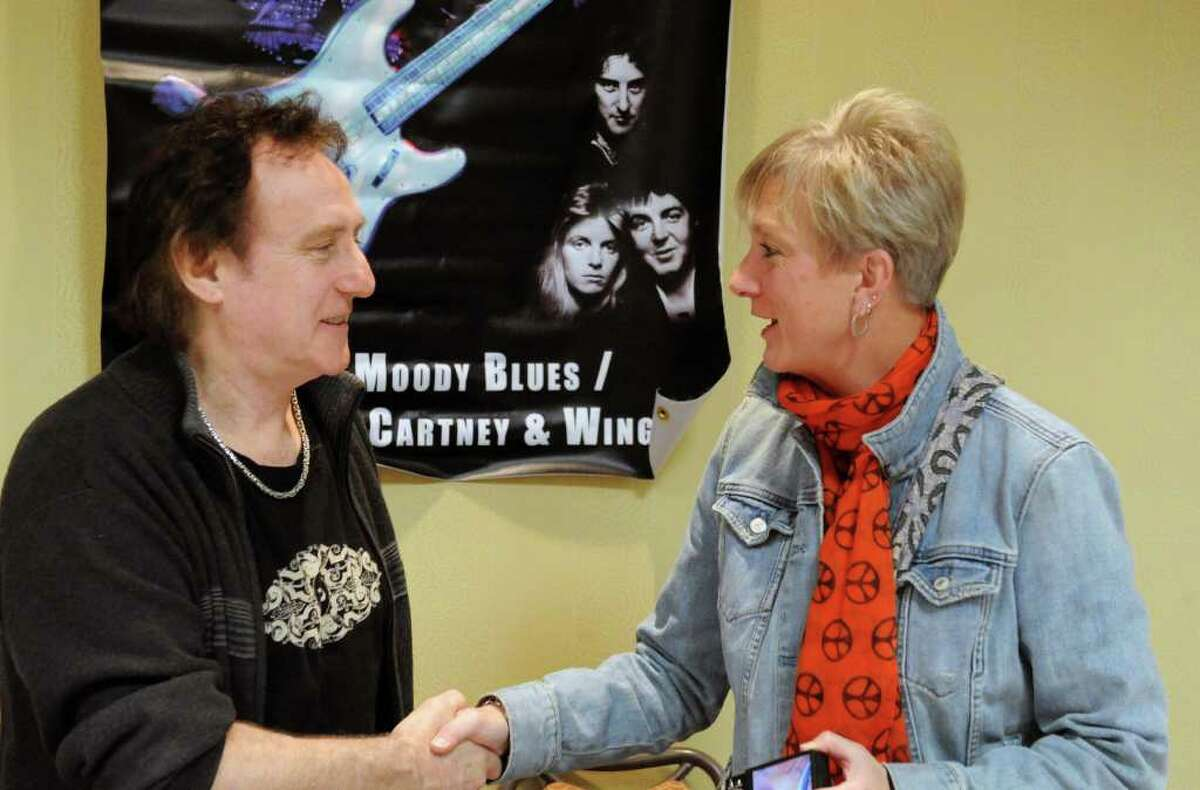 Susan Derbacher meets Denny Laine, who with Paul and Linda McCartney co-founded the music band Wings, during the