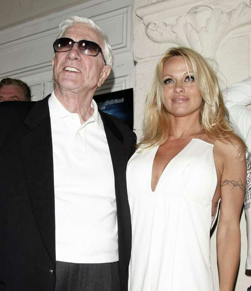 LOS ANGELES - MARCH 27: Actors Leslie Nielsen (L) and Pamela Anderson arrive at the premiere of Dimension Film's