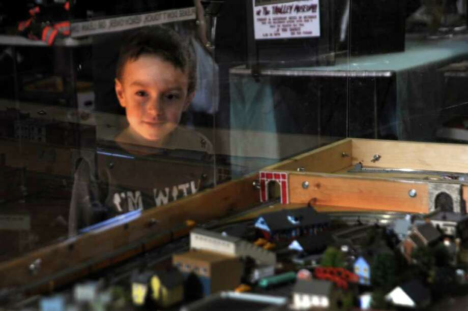 Alex Raybin, 5, of Greenwich, watches model trains go around a track at the Westchester Model Railroad Club's Fall Train Meet, at the Eastern Greenwich Civic Center, on Sunday, Nov. 28, 2010. Photo: Helen Neafsey / Greenwich Time